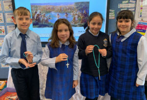 St Charles Waverley Students holding Rosary beads