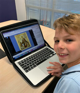 Year 2 student, Charles, with his favourite Mary picture.